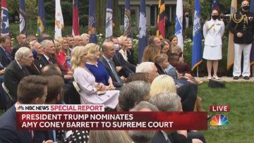 An NBC video still-frame of a crowd closely seated on a ceremonial lawn.
